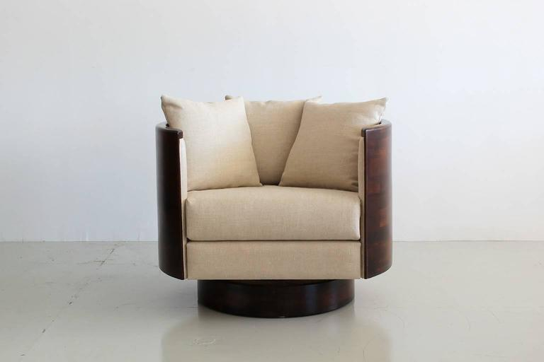 Newly produced pair of barrel back swivel chairs with solid butcher block wood backs. New linen upholstery. Sleek design with comfortable style. Priced as a pair.