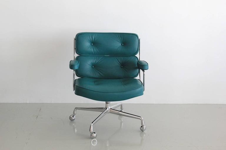 Classic office chair from the Time Life building in New York. New teal blue leather upholstery along with newly polished aluminum base and casters. Chair has an adjustable height with tilt and swivel. Multiple chairs available. Can be COL or COM.
