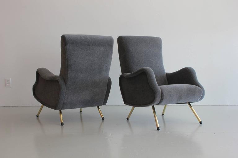 Handsome pair of Italian chairs in the style of Marco Zanuso. Chairs have gorgeous lines, brass legs and wood ball feet! Reupholstered in luxurious high pile mohair in heather grey!