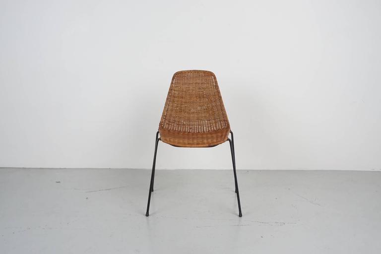 Handsome Italian wicker and iron chairs with simple bucket seat by Carlo Graffi et Franco Campo. An organic alternative to the Eames fiberglass chair!  Sold individually - 10 available.