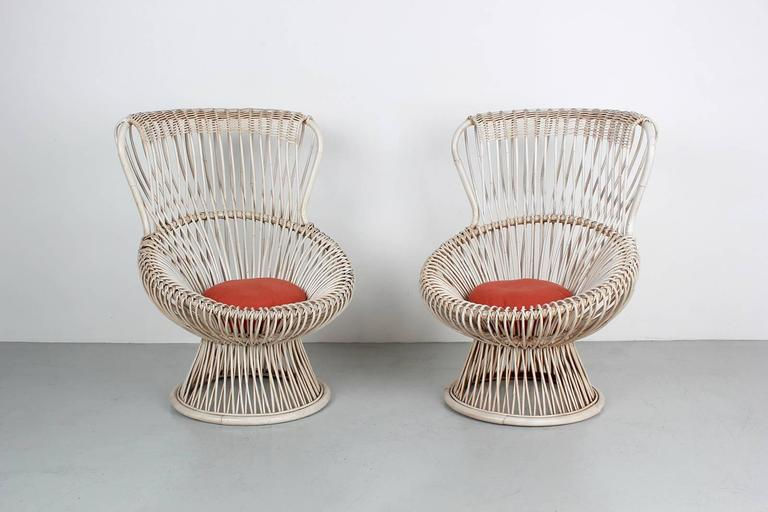 Fantastic sculptural Margherita chairs by Franco Albini. Excellent vintage condition with newly upholstered seat cushions in burnt orange linen. Newly refinished in a wonderful white wash.