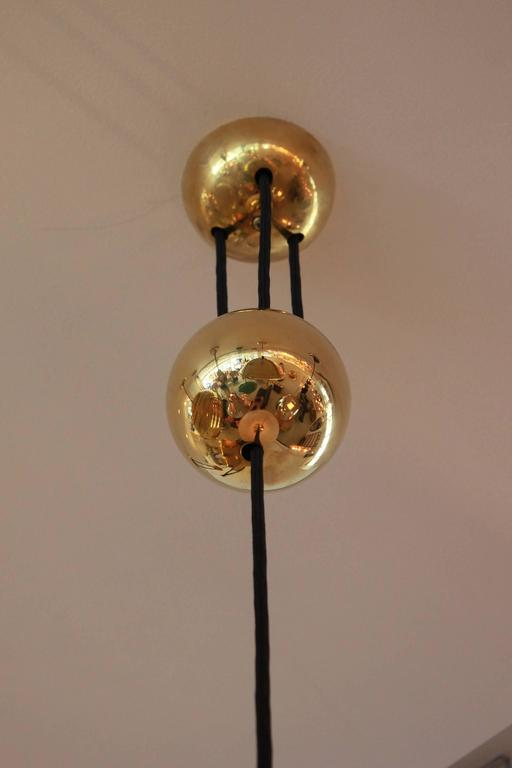 Pendant by Florian Schulz with shade and brass counter balance.