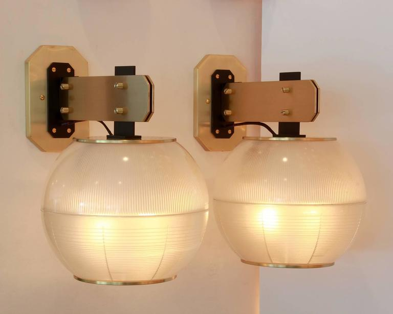 Pair of globe sconces with ribbed and textured glass. In the style of Gardella, possibly made by Stilnovo, circa 1964. Large in scale with beautiful brass hardware. Newly rewired.