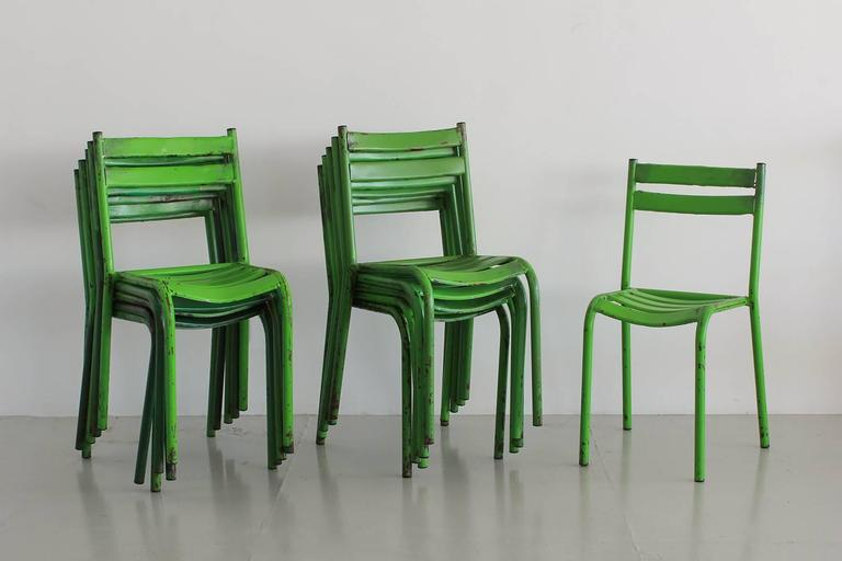 Set of 28 French Cafe chairs with fantastic green original paint. Wonderful patina and shape. Sold individually.