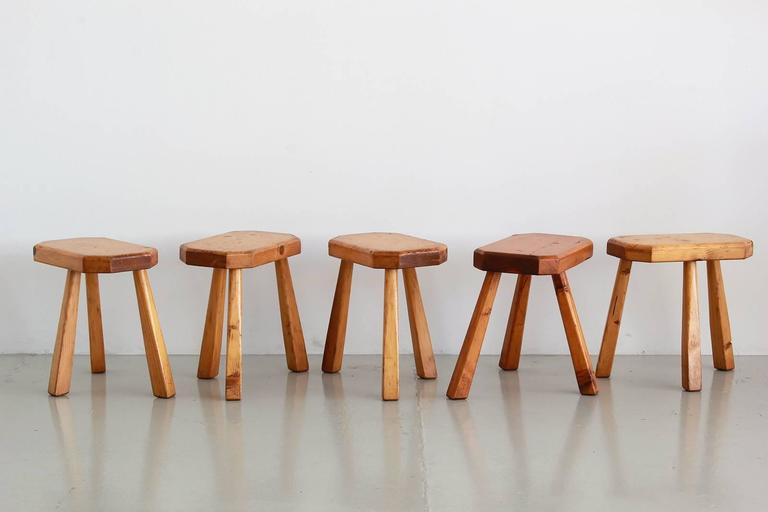 Petite oak stools in the style of Charlotte Perriand with three legs and octagon shaped seats. Three available. Sold individually.