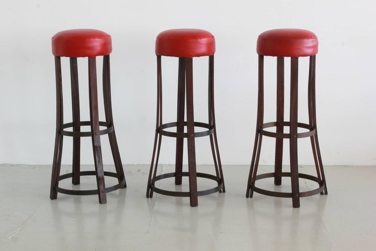 Great set of three Italian barstools with curved legs and original leather upholstered seat.