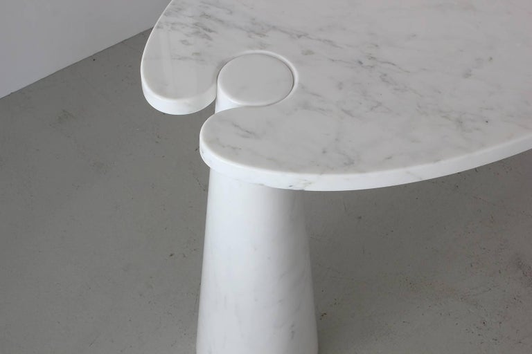 Gorgeous marble console from Mangiarotti's Eros series. Beautiful white Carrara marble top held by two white marble conic pedestals with light grey veining throughout.