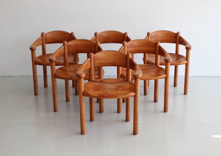 Rare Set of six sculptural armchairs by Swedish architect Rainer Daumiller. Fantastic sculptural shape and wonderful patina to the wood formed seats. Arm height: 24.5