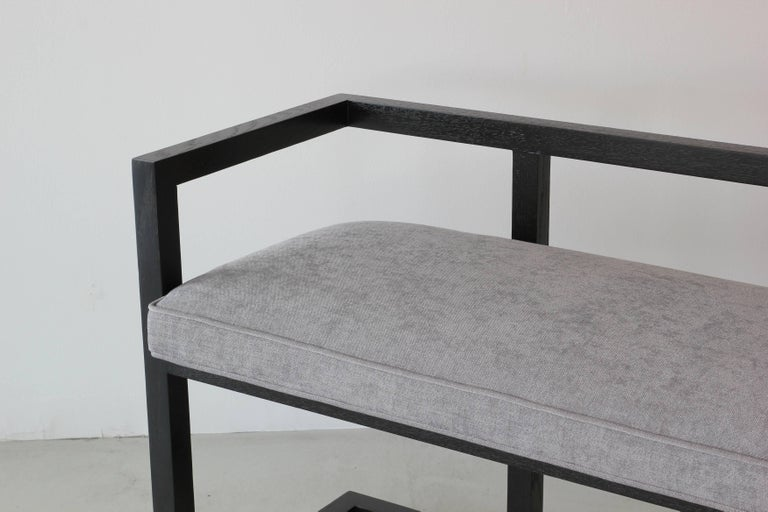 Newly produced by Orange - simple walnut bench stained in ebony and upholstered in grey linen.