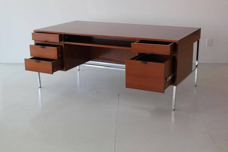 Joseph-Andre´ Motte double-sided presidential desk for Dassas. Beautifully refinished mahogany with leather pulls and chrome base. Slight peeling to chrome due to age.