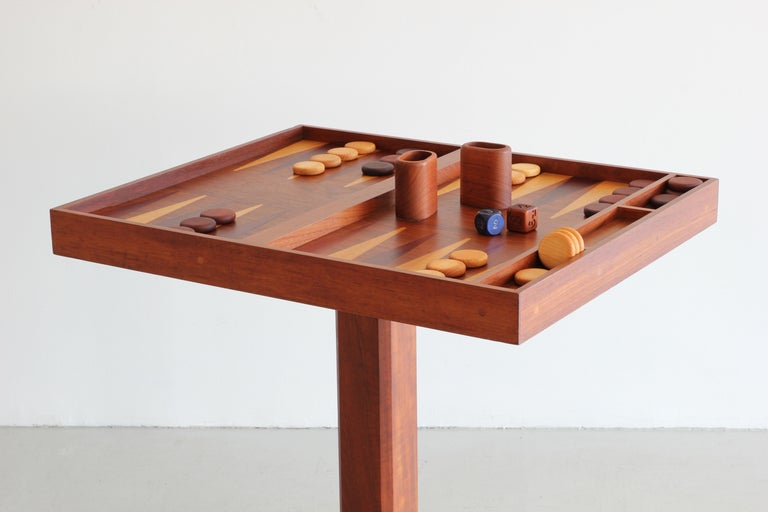 One of a kind artisan backgammon table on pedestal base with assorted inlaid woods. 