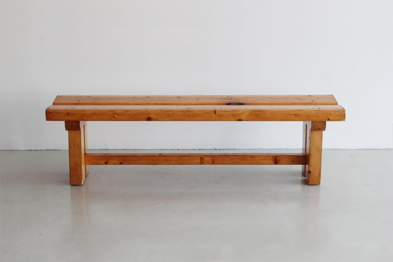 Exquisite bench by Charlotte Perriand for Les Arcs Wonderful patina to the pine wood with architectural angles.