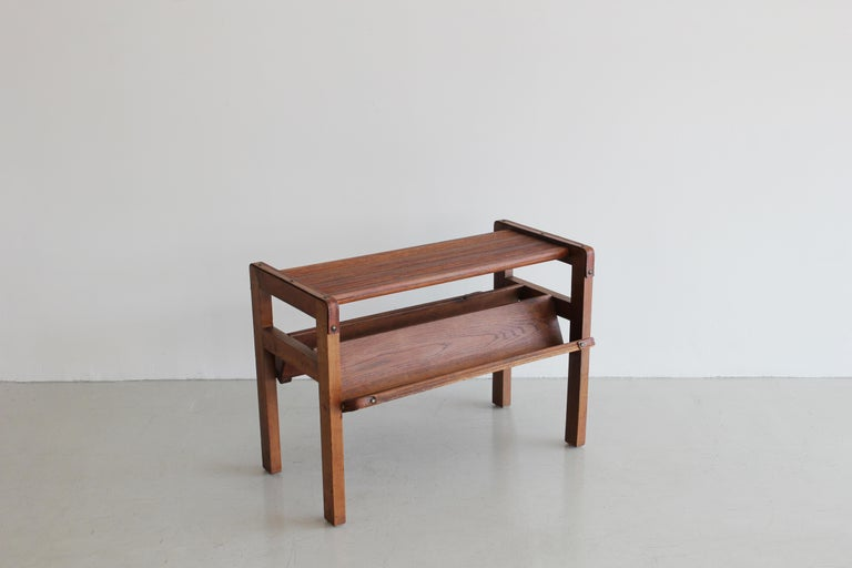 Handsome oak magazine table by Jacques Adnet. Rectangular form with slatted grooved top, inverted