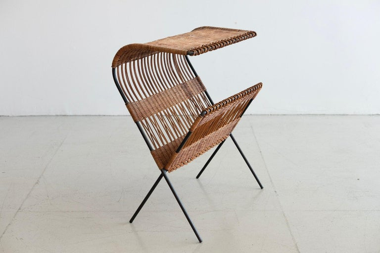 Sculptural iron and wicker Italian table which is also a magazine or book holder!