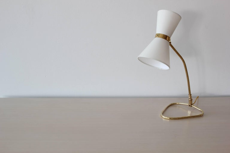 Wonderful table lamp in the style of Pierre Guariche with brass triangular base and new silk cone shades. Newly rewired.