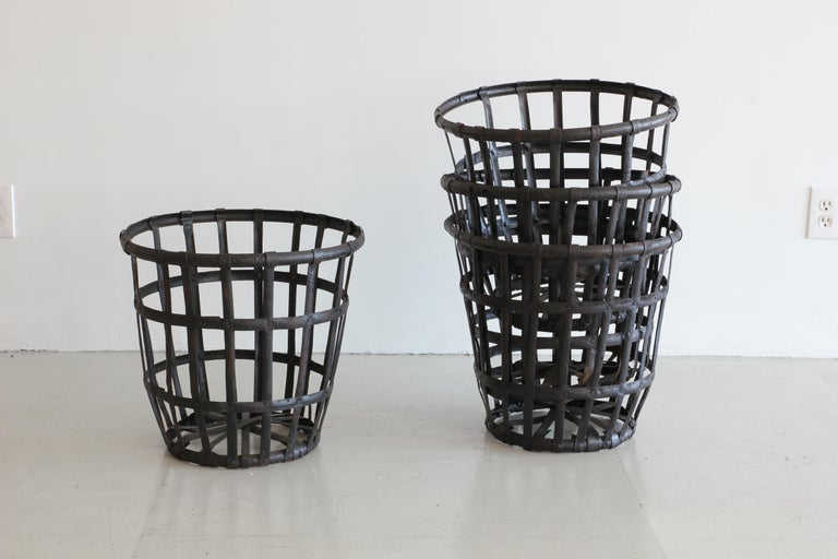 Excellent cage style baskets in black iron with heavy patina. Sold individually. Five available.