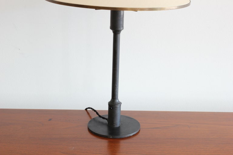 Incredible burnished bronze table lamp with cone shade called the Kongelys Lamp by Niels Rasmussen Thykier for Fog & Mørup. Original metal fittings on shade. 