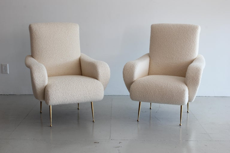 Beautiful and comfortable Italian style chairs in our signature cream wool bouclé and tapered polished brass legs. Newly made in Los Angeles. Custom options available.   Priced as a pair. Can be made to order individually.