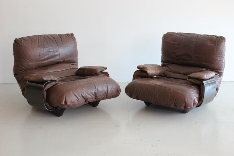 Pair of incredible Marsala lounge chairs by Michel Ducaroy manufactured by Ligne Roset in France during the 1970s. Original leather and logo on upholstery and frame. Sold as a pair.