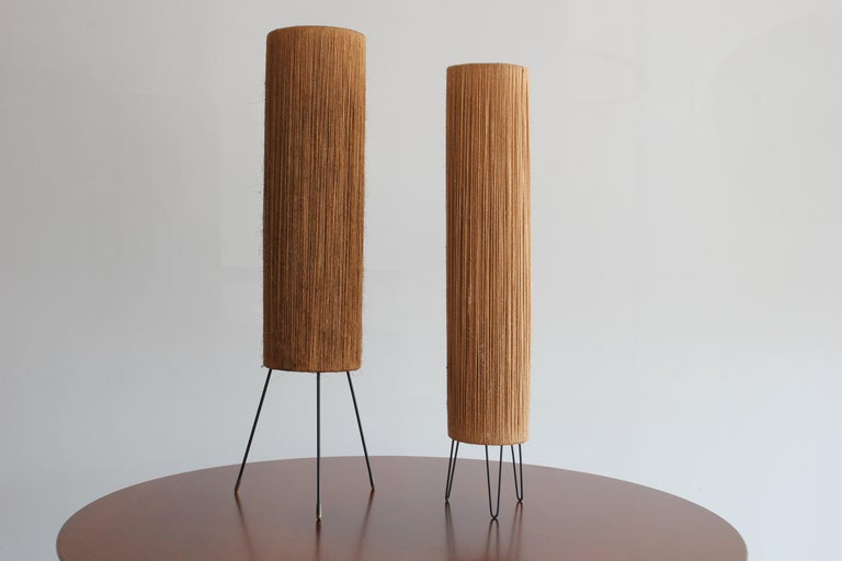 2 slightly different table lamps by Ib Fabiansen for Fog & Mørupwith.  Hemp string on iron tripod bases. Newly rewired.  Priced individually.   Measures: H 89.5 cm diameter 19 cm H 83 cm, diameter 15 cm.