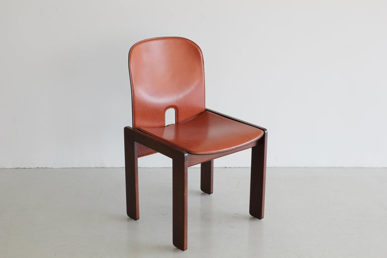 """A set of ten """"121"""" chairs by Afra & Tobia Scarpa. Produced by Cassina Molded wood wrapped in leather and a base of Italian walnut. Beautiful condition and rare set."""