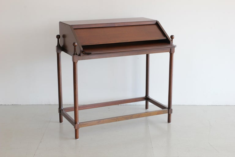 Small desk by Italian designer Fratelli Prosperio with unique mechanism that opens as you pull out the writing surface. Great for an entry!