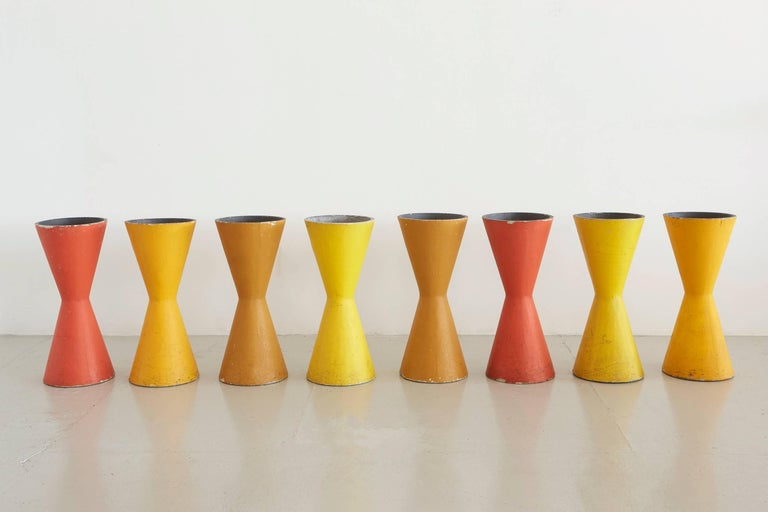 Rare colorful Diablo hourglass pots that can be flipped to also be used as a stool or table! Fantastic color and patina, priced individually.