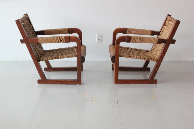 Pair of Francis Jourdain attributed chairs with incredible woven rope seats, back and arms. 