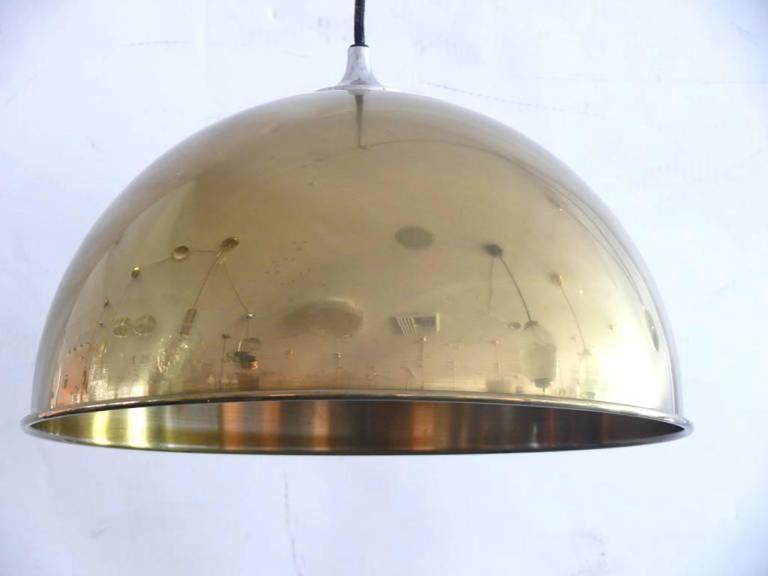 Double brass counterbalance pendant by Florian Schulz. Two brass pendants suspended, each with their own brass ball counter balance pulley system. One centre canopy supports both pendants. Each light is adjustable in height without effecting the