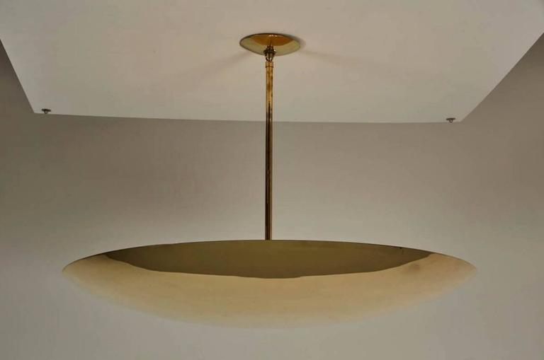 Beautiful polished brass dome ceiling pendant produced by Orange. 