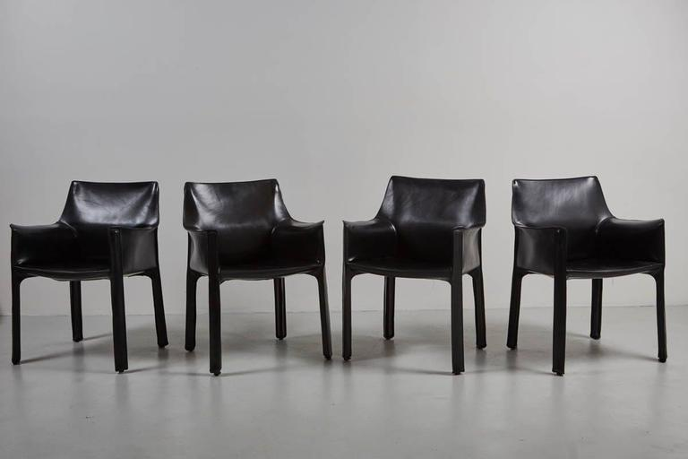 Black cab armchairs by Mario Bellini for Cassina. Leather has wonderful patina and is in excellent condition.  6 available and priced individually.