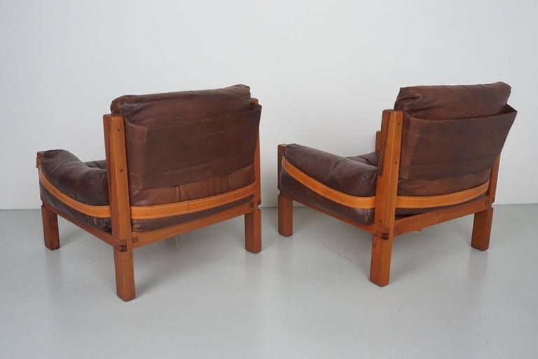 Mid-20th Century Pair of Leather Club Chairs by Pierre Chapo For Sale