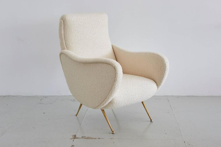 Marco Zanuso lady chair style with matching ottoman. Reupholstered in creamy wool bouclé and newly polished brass legs.