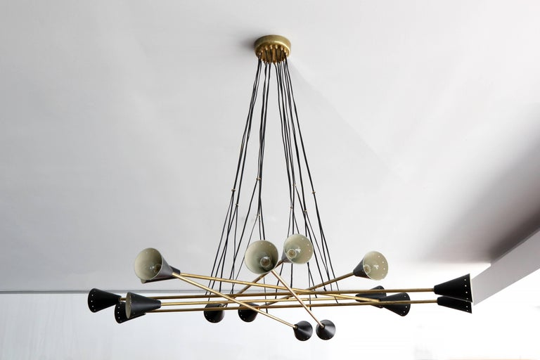 Incredible black and brass sixteen-light chandelier with woven wires for a stunning Silhouette.