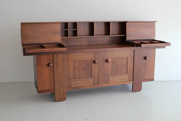 Large oak credenza designed by Silvio Coppola for Bernini in 1964. 