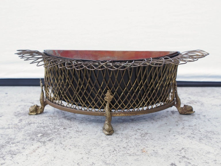 19th century French Demilune form Wire Jardiniere with dolphin feet and tin liner.