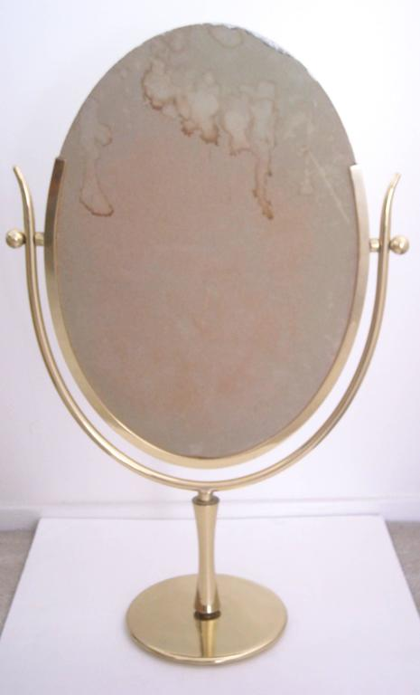"Charles Hollis Jones ""Wishbone"" vanity brass mirror. 4"