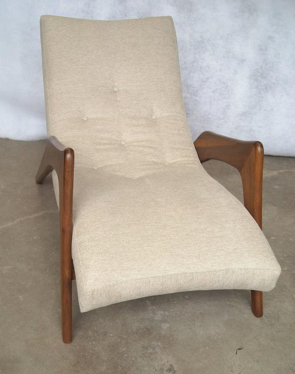 Very nice and rare Pearsall lounge chair, walnut refinished and restored, new fabric.