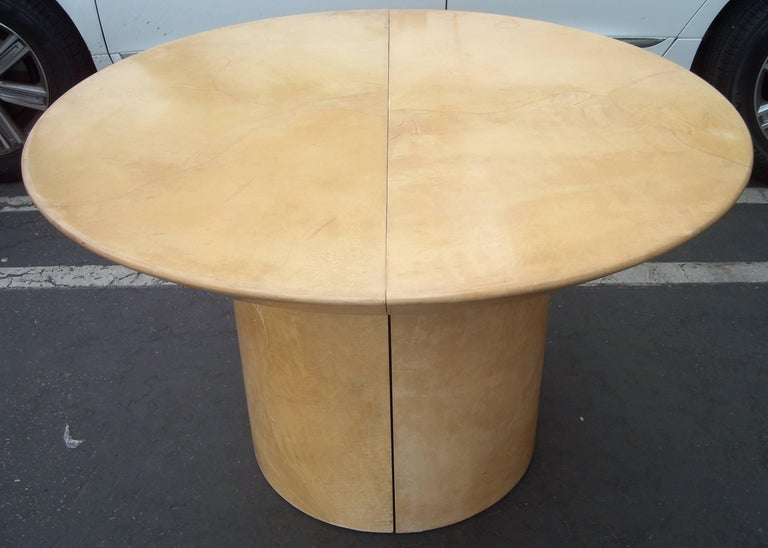 This is an amazing dining table in goatskin. We could not find any label, but there are several designers in the 1980s that have designed parchment goatskin tables, Like Sally Sirkin Lewis , Karl Springer, etc. This table is round and diameter of 48