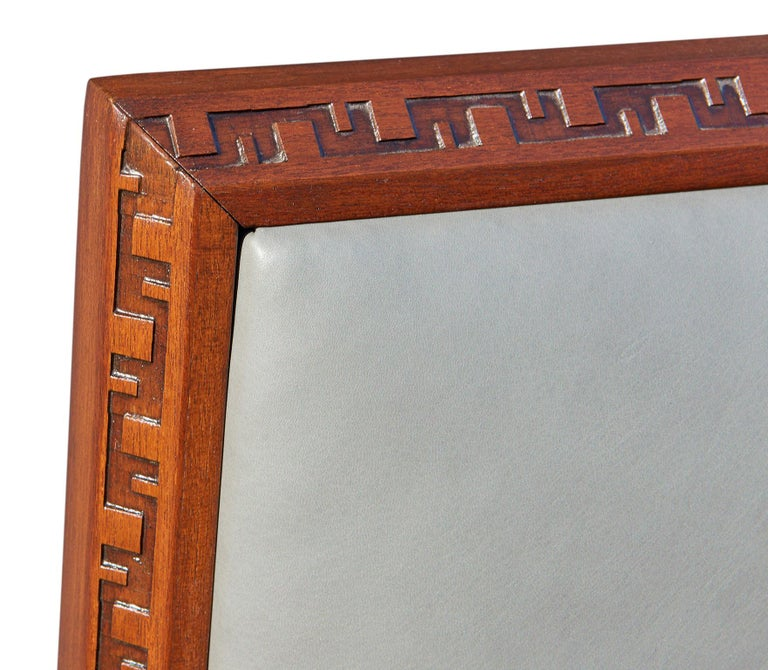 Designed by Frank Lloyd Wright for Henredon in 1955, this headboard for a king-size bed is made of solid African mahogany, its edges carved with Wright's distinctive Taliesen