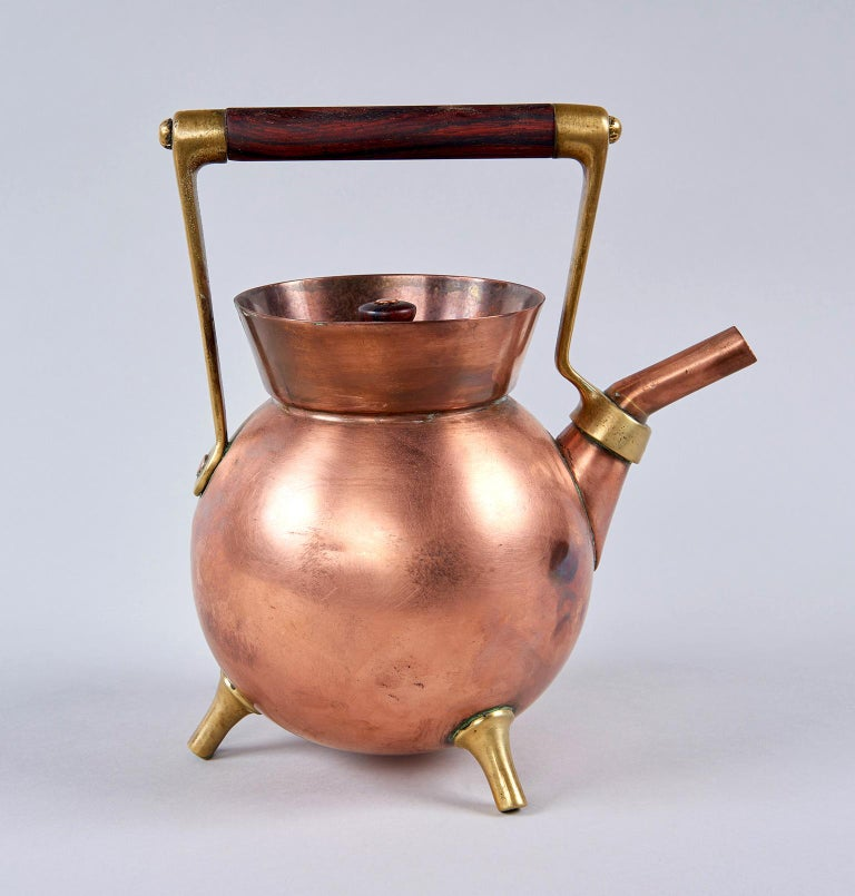 Unusually geometric in form, this extraordinarily inventive copper and brass kettle looks like a Bauhaus thesis project from 1930 but was actually created in England in 1878 by the world's first Industrial designer, proto-modernist Dr. Christopher