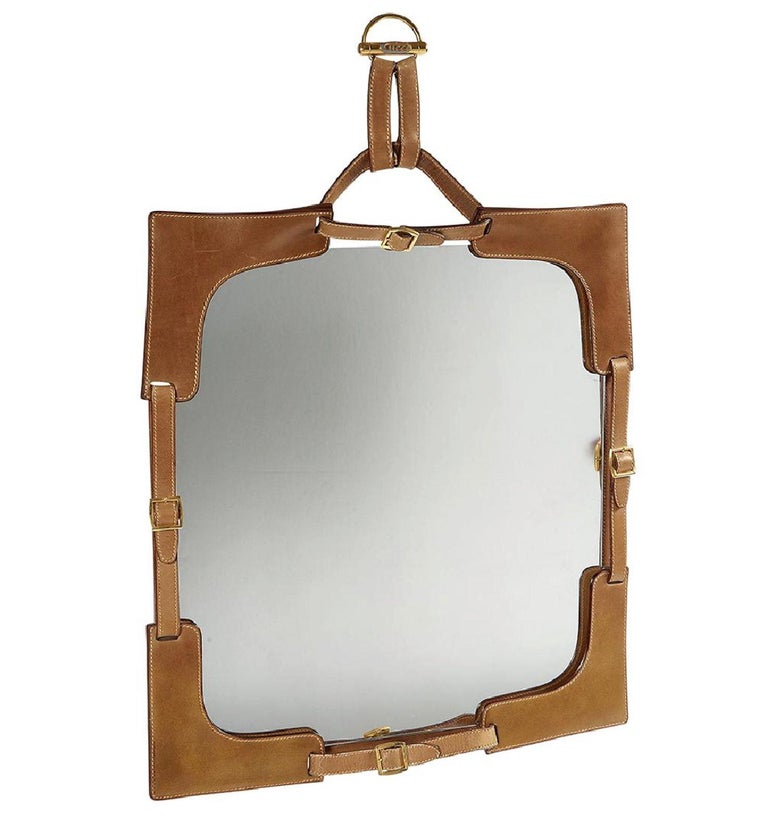 Few vintage artifacts for the home express effortless chic with such clarity as this leather-framed mirror made by Gucci in the 1970s. This uncommon piece delivers all the best Gucci connotations; it is at once luxurious and casual, Italian and