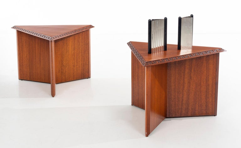 A pair of striking, architectural tables/stools designed by Frank Lloyd Wright for Henredon in 1955. The edges of the triangular tops are carved with Wright's famous Taliesen