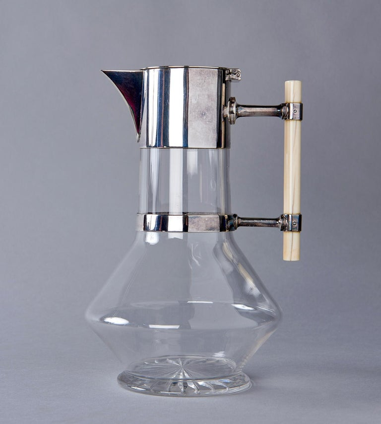 This iconic wine decanter, designed in 1881 by Dr. Christopher Dresser for London silversmiths Jonathan Wilson Hukin and John Thomas Heath, presciently anticipates the values of 20th century design, such as structural honesty and