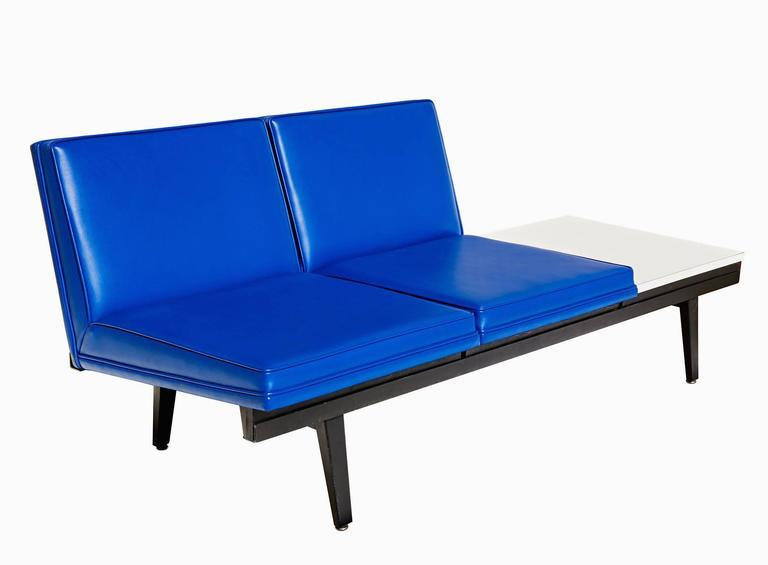 A modular two-place sofa, with an integrated coffee table, from George Nelson's
