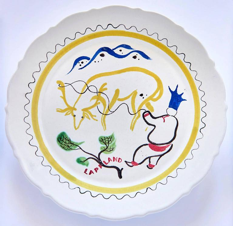 This set of faience dinner plates (nine altogether, though only eight appear in the group photograph) was created by Stig Lindberg in the late 1940s to celebrate the various regions of Sweden. All of the paintings are done in Stig Lindberg's