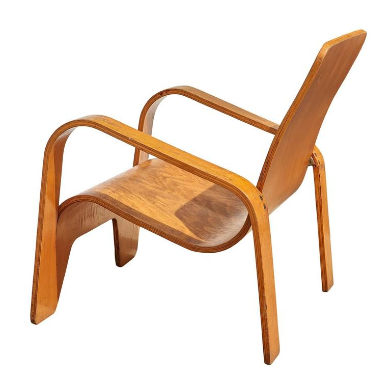 The Lawo chair, so named because it was made of LA-minated WO-od, was brilliantly constructed from a single sheet of birch plywood, which is cut and then bent in different planes to create the seating surfaces, arms, and legs of the chair. The rear