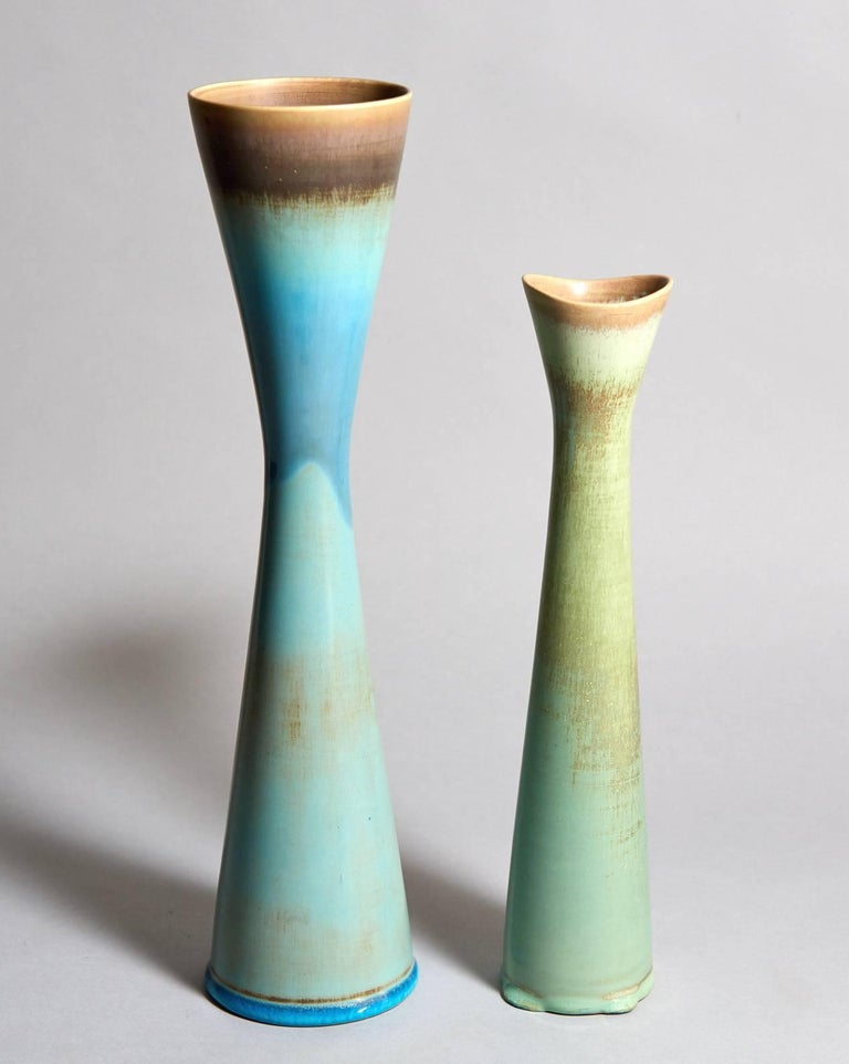Prof. Stig Lindberg (1916-1982) was a man of very many talents, and his restless creativity yielded an amazing variety of objects. Their wide range of form, surface detail, and glaze color makes any grouping of these unique stoneware studio vases a
