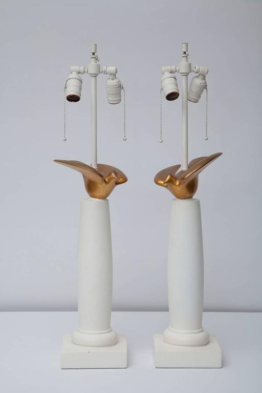 Sirmos white plaster finish lamps. Doric column bases topped by patinated gold leafed doves.