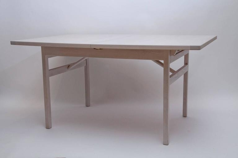 Classic clean-lined dining table by Jens Risom. We've bleached the walnut to palest grey to highlight the stunning pattern of the wood grain. Table measures 60